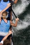 Dragon Boat. Racers paddling - looking down on the boat from above Royalty Free Stock Photo