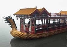 Dragon Boat in China. Rainy scenery including a dragon-styled boat near Beijing in China Royalty Free Stock Image