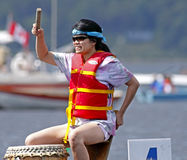 Dragon boat drummer beat Stock Images