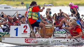 Dragon boat drummer leads team Royalty Free Stock Images