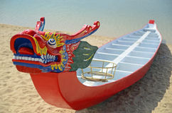 Dragon Boat. Empty bright red dragon boat on lake shore Royalty Free Stock Photos