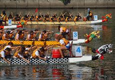 The 2013 Dragon Boat Festival in Kaohsiung, Taiwan. KAOHSIUNG, TAIWAN - JUNE 11: Four unidentified teams compete in the 2013 Dragon Boat Races on the Love River Royalty Free Stock Photography