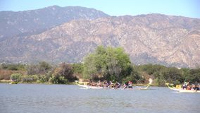 Dragon boat festival at Santa Fe Dam Recreation Area stock video