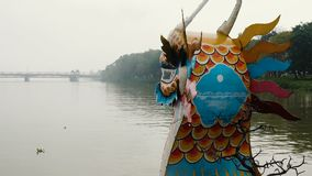 Dragon boat on the Perfume River. Dragon boat moving up the Perfume River on a cloudy day, Hue, Vietnam stock video footage