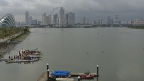 Dragon Boat. Race at Marina Barrage Singapore with Singapore Flyer and cityscape at the background stock video