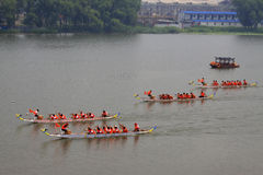Dragon boat race scene in Chinese traditional Dragon Boat Festiv Stock Photos