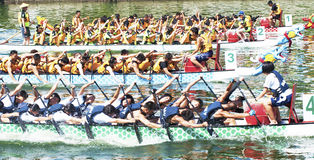 Dragon Boat Races. KAOHSIUNG, TAIWAN - JUNE 12: unidentified team compete in the 2013 Dragon Boat Races on the Love River on June 12, 2013 in Kaohsiung Stock Image