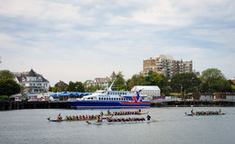 Dragon Boat Races at Victoria, British Columbia. Dragon boat races are a popular annual event held during the Dragon Boat Festival in the summer Stock Photos