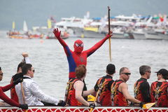 DRAGON BOAT RACING. Racer imitate Spider man in Dragon Boat Racing taken on June 12th, 2013 at hong kong Royalty Free Stock Image