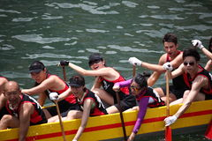 DRAGON BOAT RACING. Dragon Boat Racers Rowing Their Boat Royalty Free Stock Images