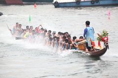 DRAGON BOAT RACING. Dragon Boat Racers Rowing Their Boat Stock Photography