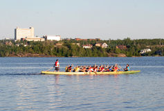 Dragon boat season. Dragon boat races are the vehicle of choice for charitiesin the sudbury ontario. sudbury has 700 lakes in the sudbury area Royalty Free Stock Photography