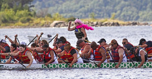 Dragon boat two teams pink sweep. SAINT JOHN, CANADA - AUGUST 28: Two teams race side by side at the Saint John Dragon Boat Festival, a fundraising project of St Stock Image