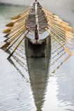 Dragon Boat. A wooden dragon boat in the lake.Inverted reflection in water Royalty Free Stock Photography