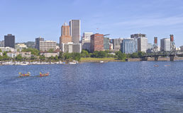 Dragon boats annual races and Portland Oregon skyline. Royalty Free Stock Photos
