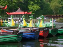 Dragon boats on boating lake Stock Photography