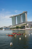 Dragon boats with MBS as backdrop Royalty Free Stock Images