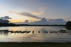 Dragon boats parked at Bedok Reservoir Park during evening sunset. Stock Photos