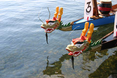 Dragon boats wait for next race in Grand Marais, Minnesota. Dragon boats in the harbor on Lake Superior at Grand Marais royalty free stock photo