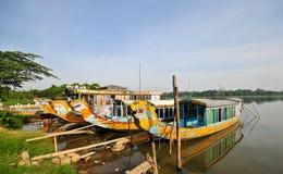 Dragon boats waiting at pier in Hue, Vietnam Stock Image