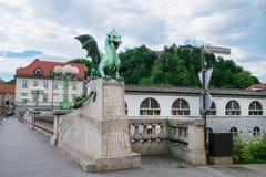 Dragon Bridge and castle in Ljubljana, Slovenia Stock Image