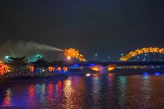Dragon bridge in Da Nang, Vietnam, at night. The dragon blowing hot fire out of its mouth. A famous attraction in Da Nang. Dragon bridge in Da Nang, Vietnam, at royalty free stock photos