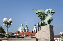 Dragon Bridge, Ljubljana. Dragon Bridge with St Nicholas Cathedral in the background, in Ljubljana, Slovenia royalty free stock photo