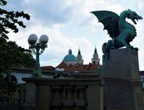 Dragon bridge and St. Nicholas cathedaral Ljubljana Royalty Free Stock Photo