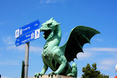 Dragon bridge in a summer day in Ljubljana with turistic signs, Stock Images