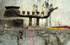 Dragon candles. Candles and insense at buddhist temple in thailand stock photos