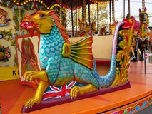 Dragon on a carousel. Fairground carousel dragon in close up stock photo