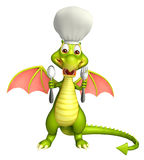 Dragon cartoon character  with chef hat and spoons Stock Photo