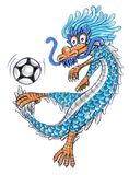 Dragon cartoon playing football Royalty Free Stock Image