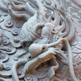 Dragon carved from stone Royalty Free Stock Photo