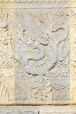 Dragon carved in white marble rock in the Eastern Royal Tombs of Stock Image