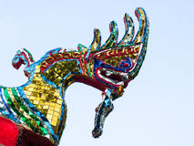 Dragon Carving. The carved dragon, decorated with stained glass royalty free stock photos