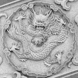 Dragon carving at temple Stock Photos