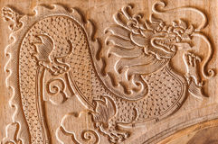 Dragon carving. On the wood not yet painted Royalty Free Stock Photography