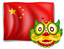 A dragon and the Chinese flag Royalty Free Stock Photography