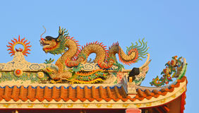 Dragon on the Chinese temple roof in Thailand Royalty Free Stock Photography
