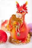 Dragon with Christmas decorations. Royalty Free Stock Photo