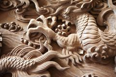 Dragon claw carvings. Shot of handmade wood dragon claw details stock photography