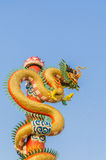 Dragon. Color full dragon on blue sky Royalty Free Stock Photo