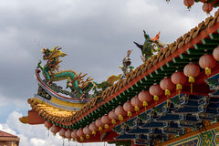 Dragon and Crane Sculpture on Chinese Temple Roof Stock Photo