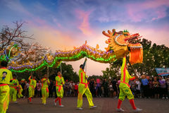 Dragon Dance in a Chinese New Year`s Celebration. BANGKOK, THAILAND - FEBUARY 20: A group of people perform a dragon dance during Chinese new year`s celebration