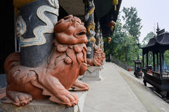 Dragon-decorated columns with lion-shaped pedestals of ancient C Stock Images