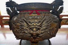 Dragon decorated at the incense burner  of Chinese shrine in Thailand Stock Photo