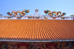 Dragon decorated at the roof of Chinese shrine in Thailand. Dragon decorated at the roof of Chinese shrine in Chonburi,Thailand royalty free stock images