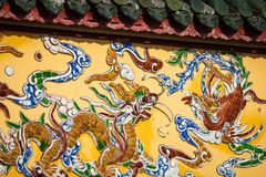 Dragon decorations. Imperial Royal Palace of Nguyen dynasty in H. Ue, Vietnam. Unesco World Heritage Site.Imperial Royal Palace of Nguyen dynasty in Hue, Vietnam royalty free stock photos