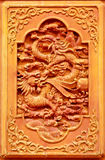 Dragon design on the wooden door Royalty Free Stock Photography